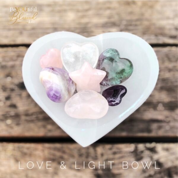 selenite bowl filled with heart shaped crystals